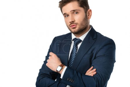 young businessman with crossed arms looking at camera isolated on white