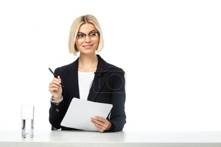 young happy freelancer holding papers and pen at workplace isolated on white