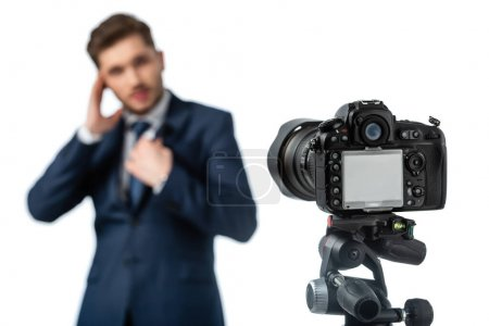 selective focus of digital camera near news anchor on blurred foreground isolated on white