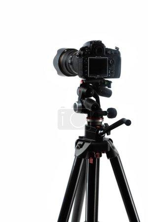 photo camera on tripod isolated on white