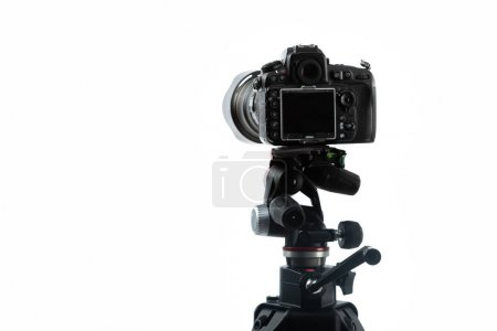 Photo for Professional digital camera on tripod isolated on white - Royalty Free Image