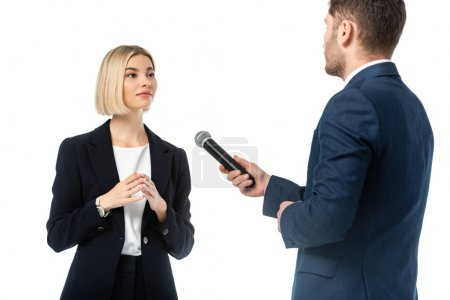 news anchor with microphone taking interview from young blonde businesswoman isolated on white