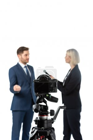 Photo for Selective focus of digital camera near reporter and businessman on blurred background isolated on white - Royalty Free Image