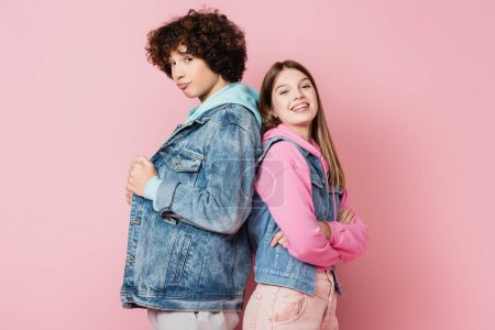 Photo for Teenagers in casual clothes looking at camera on pink background - Royalty Free Image
