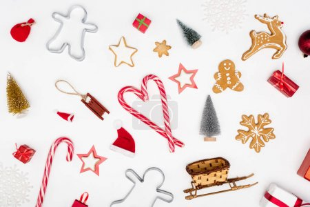 Photo for Top view of candy canes and different cookies near christmas baubles on white background - Royalty Free Image