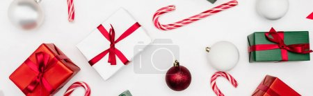 Photo for Website header of gift boxes, christmas balls and candy canes on white background - Royalty Free Image