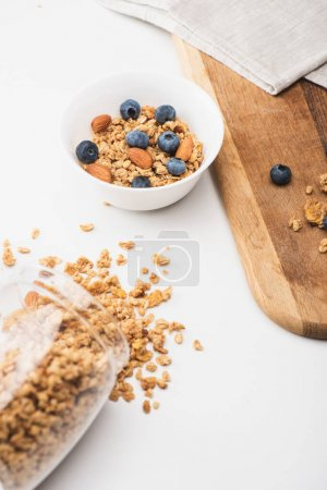 delicious granola with nuts and blueberry on white background