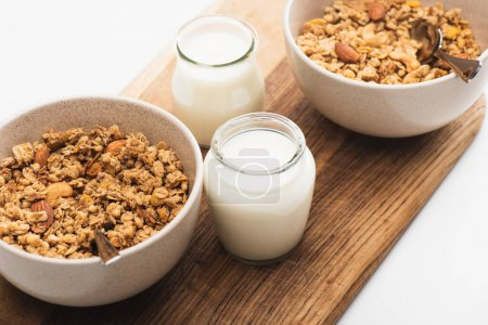 delicious granola with nuts and yogurt isolated on white
