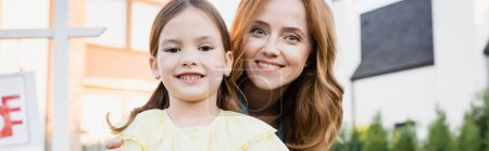 Photo for Portrait of happy mother and daughter looking at camera on blurred background, banner - Royalty Free Image