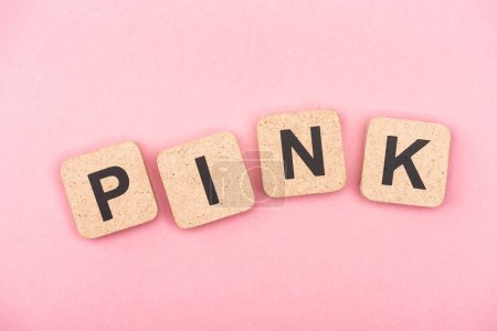 top view of word pink on cubes