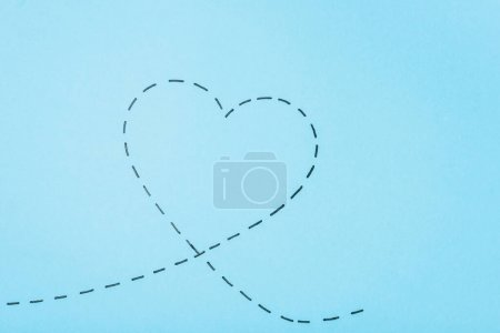 Photo for Top view of dotted line heart on blue background - Royalty Free Image