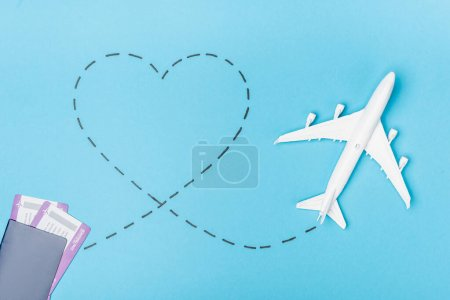Photo for Top view of white plane model and tickets on blue background - Royalty Free Image