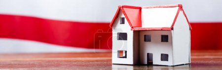 house model near red stripped flag on blurred background, banner