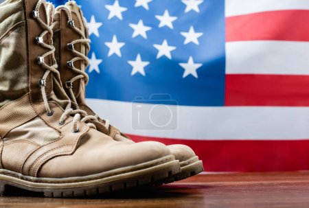 army boots near american flag on blurred background