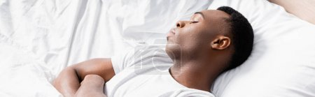 Photo for African american man sleeping on white bedding, banner - Royalty Free Image