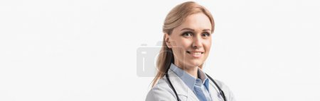 Photo for Happy nurse in white coat looking at camera isolated on white, banner - Royalty Free Image