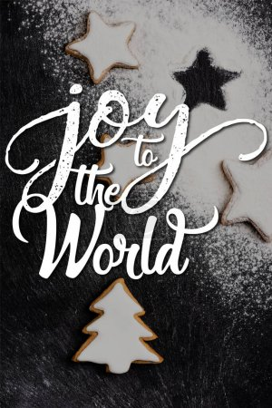Photo for Top view of christmas gingerbread cookies covered with sugar powder near joy to the world lettering - Royalty Free Image