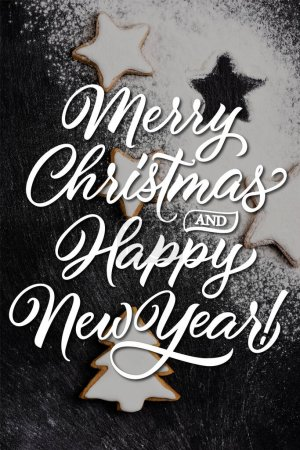 Photo for Top view of christmas gingerbread cookies covered with sugar powder near merry christmas and happy new year lettering - Royalty Free Image