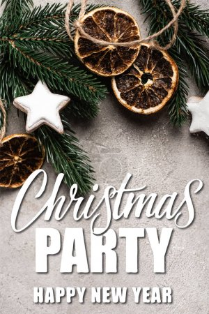 Photo for Top view of dried orange slices, cookies and pine branch near christmas party lettering on textured background - Royalty Free Image