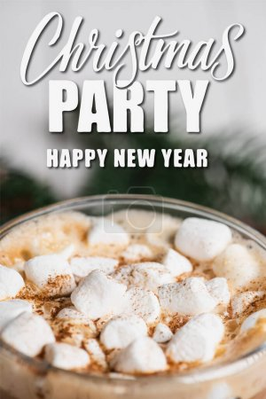 Close up view of glass cup of cocoa with marshmallows and cinnamon near christmas party, happy new year lettering