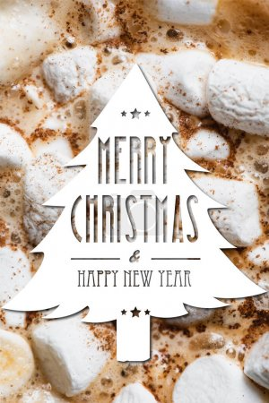 Photo for Close up view of cocoa, marshmallows and cinnamon with merry christmas and happy new year lettering in pine illustration - Royalty Free Image