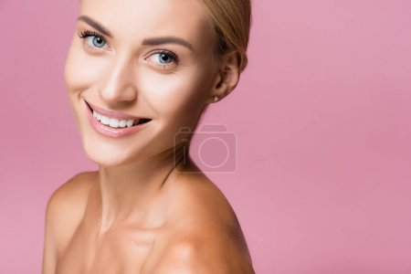 Photo for Smiling beautiful blonde woman with perfect skin isolated on pink - Royalty Free Image