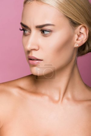 Photo for Beautiful blonde woman with perfect skin looking away isolated on pink - Royalty Free Image