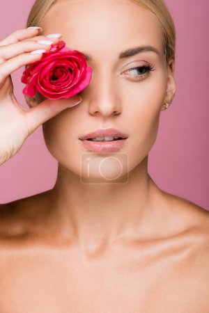 Photo for Beautiful blonde woman with rose flower on eye isolated on pink - Royalty Free Image