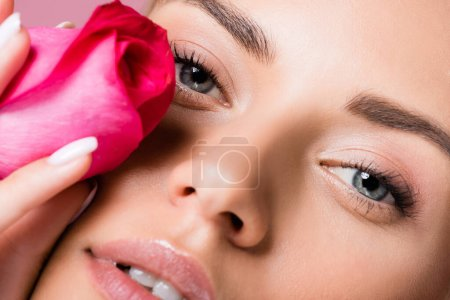 closeup of beautiful woman with rose flower