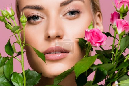 Photo for Beautiful blonde woman with rose bouquet isolated on pink - Royalty Free Image
