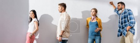 Photo for Multicultural people and pregnant woman standing near wall in queue, banner - Royalty Free Image