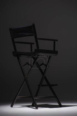 black director chair on dark grey background, cinema concept