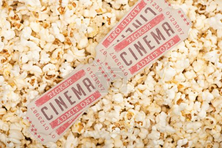 Photo for Top view of cinema tickets on airy crispy popcorn - Royalty Free Image