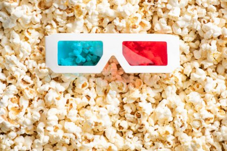 Photo for Top view of 3d glasses on crunchy popcorn, cinema concept - Royalty Free Image