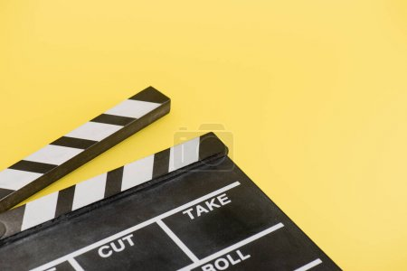 Photo for Close up view of clapperboard on yellow background, cinema concept - Royalty Free Image
