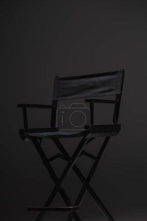 black, modern director chair on dark grey background, cinema concept