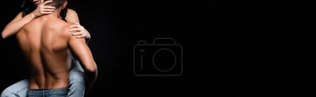 Photo for Cropped view of shirtless man holding girlfriend isolated on black, banner - Royalty Free Image