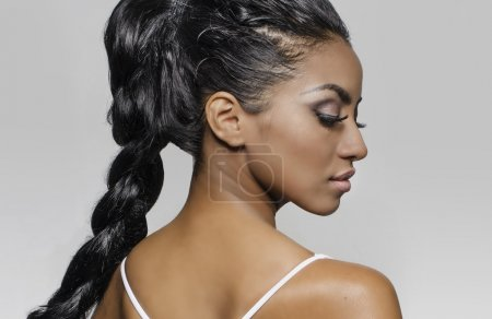 Beautiful young woman - profile viewpoint - braided long hair