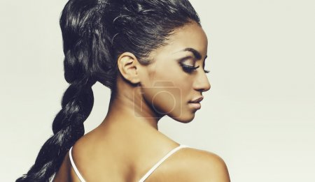 Side profile of beautiful exotic young woman