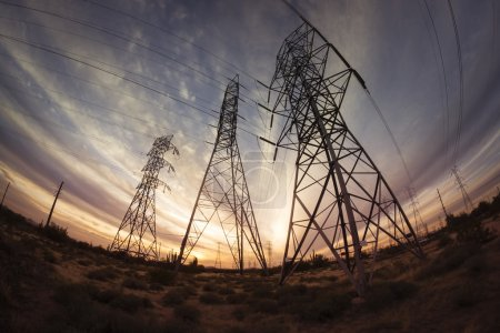 Electricity power pylons at sunset