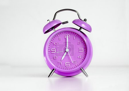 Photo for Purple analog retro twin bell alarm clock - Royalty Free Image