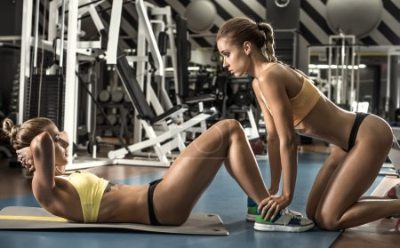 Two young fitness woman