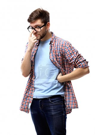 young casual man thinking
