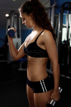beautiful fit woman exercising building muscles
