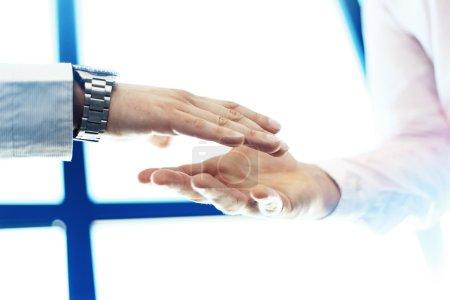 Business partnership meeting concept. Image businessman handshake.Blurred,sunlights