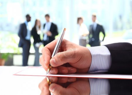 Businessman signing up contract