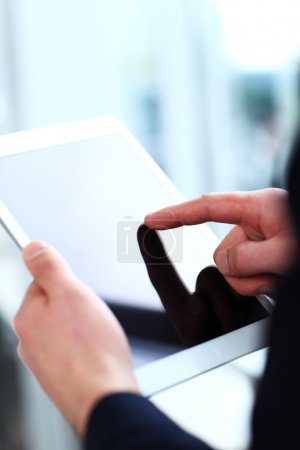 Office worker using a touchpad