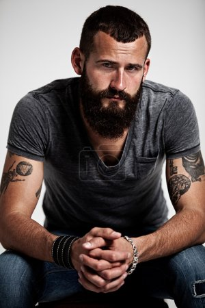Photo for Portrait of handsome bearded man with tattoos - Royalty Free Image