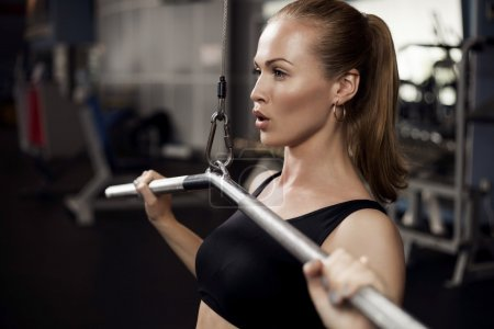 Woman exercising building muscles
