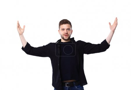 Photo for Excited handsome man with arms raised in success - Isolated on white - Royalty Free Image